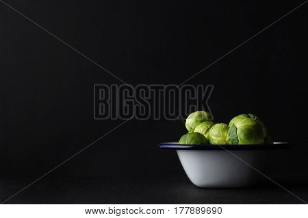 Brussel Sprouts Filling Enamal Baking Tin On Black Background