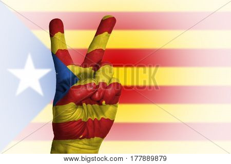 Hand Making Victory Sign, Catalonia Painted With Flag As Symbol