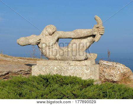 Archer sculpture on the rocky shore of the Black Sea, Cape Kaliakra, Bulgaria