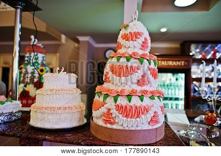 Two Wedding Cakes At The Bar Of Restaurant.