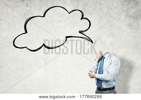 Headless businessman in empty room and blank speech bubble