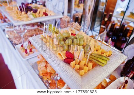 Wedding Reception Table With Different  Cheese And Snacks For Beer.