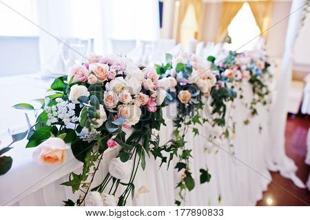 Flowers On Table Of Newlyweds At Wedding Reception.