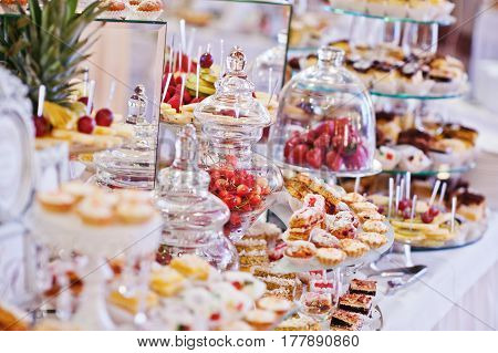 Wedding Reception Table With Different Fruits, Cakes And Sweets.