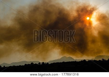 CUERNAVACA / MEXICO - MARCH 22 2017: Forest fire intensified by the winds covers wide region of the State of Mexico and Morelos. Col. del Bosque Cuernavaca Morelos Mexico.