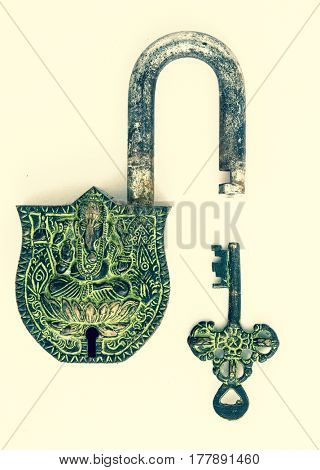 Ganesh padlock and key on white