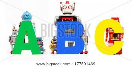 ABC robots holding up letters