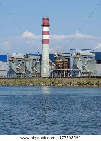 Industrial Zone with a chimney on the banks of the Gulf of Finland