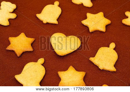 Gingerbread Christmas Decorative Cookies. Brown Chocolate Background. Close Up