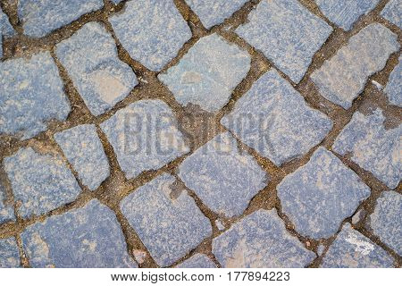 background old classic paving stones. close up