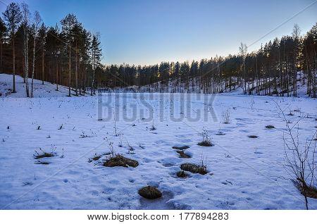 Winter Landscape. Frozen Lake. Snowdrifts. Sunset