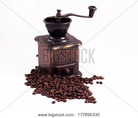 Coffee Mill, Coffee Grinder. Many Coffee Beans In The Background. Texture Of The Coffee Beans On A W