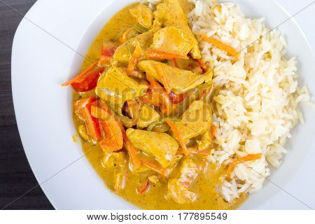 homemade chicken curry with red pepper carrots and rice