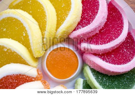 Close Up Of Round Composition Of Colorful Jellies (green, Orange, Yellow, Purple) In A Shape Of A Ha