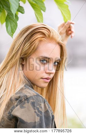 Girl Outdoors Touching A Leaf