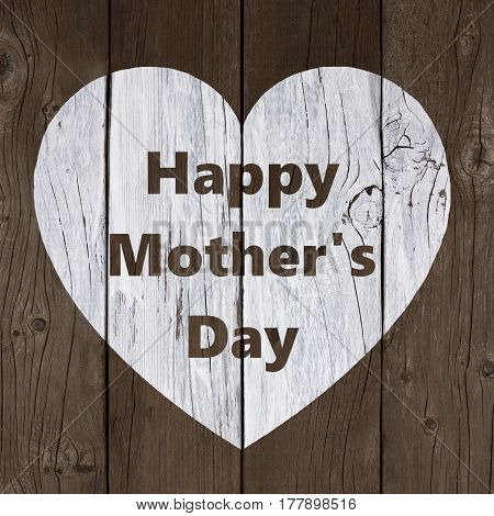 White Painted Heart With Happy Mothers Day Text Over A Rustic Old Wood Background