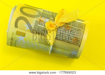 Euro bills package on a yellow background