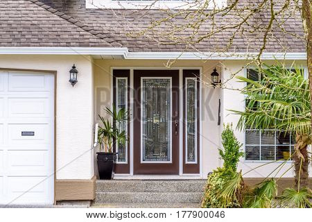 Fragment of a luxury house with entrance door and nice window.