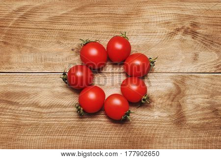 A mini tomatoes on a wooden background