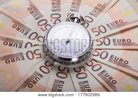 High Angle View Of A Stopwatch On Euro Notes