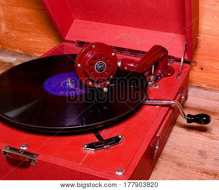 HUSTOPECE CZECH REPUBLIC - MARCH 10 2017: Image shows vintage gramophone (famous Czech brand Supraphone). The red wind-up gramophone and vinyl record (brand Ultraphon).
