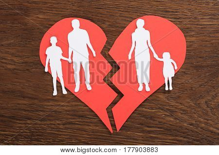Broken Heart Concept With Family Paper Cut On Wooden Desk
