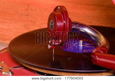 HUSTOPECE CZECH REPUBLIC - MARCH 10 2017: Image shows vintage gramophone (famous Czech brand Supraphone. The red wind-up gramophone and vinyl record (brand Ultraphon).