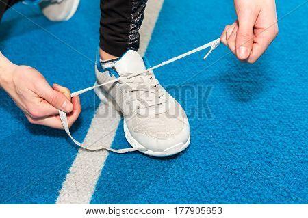 healthy lifestyle sports men tying shoelace on wooden boardwalk sunrise seaside