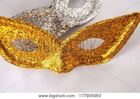 Gold And Silver Theatrical Masks On A Light Background
