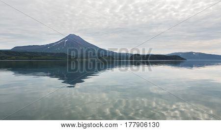 Ilyinsky stratovolcano located in the southern part of Kamchatka Peninsula near Kurile Lake.
