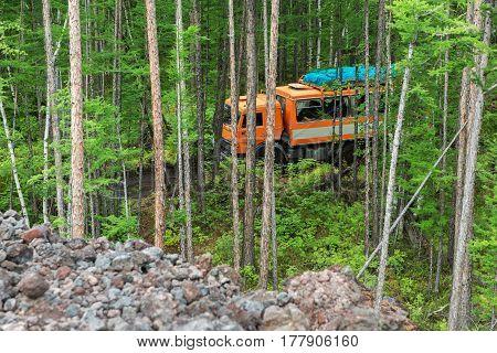 Kamchatka Peninsula, Russia - August 20, 2016: Kamaz in the taiga. Road to the Klyuchevskoy Nature Park. Kamchatka Peninsula.