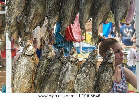 ODESSA UKRAINE - AUGUST 6 2014: Fish seller in Privoz Market Odessa Ukraine