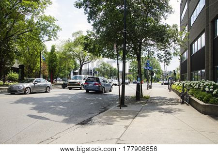 Montreal, Quebec, Canada - 18 July 2016 - Sunny Street In Montreal In Summertime. Cars, Bikes, Trees