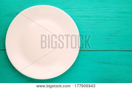 Plate On A Wooden Background.white Plate. Plate Top View. Copy Space