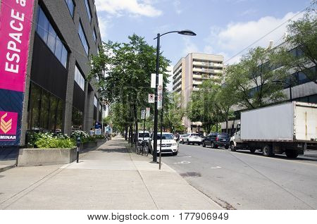 Montreal, Quebec, Canada - 18 July 2016 - Generic Sunny Green Street In Montreal In Summertime. Cars