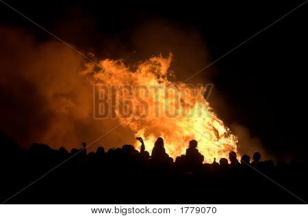 Silhouettes Of People Over Bonfire