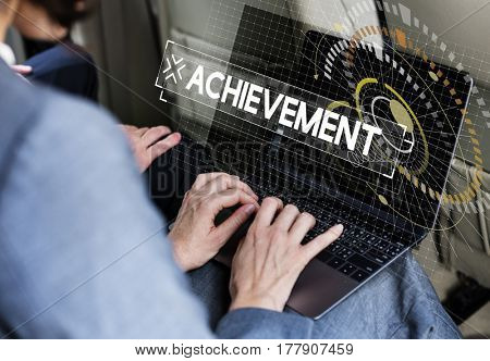 Businessman using laptop and achievement word graphic design