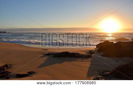 Calm peaceful sea and beach on tropical sunrise. A beautiful january sunrise in Australia.