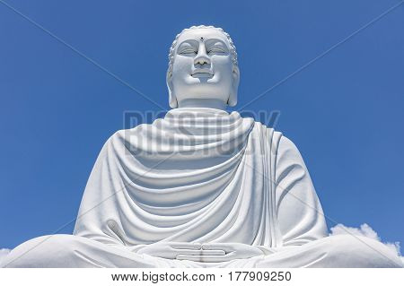 White Buddha Statue at Long Son Pagoda in sunny day at Nha Trang Vietnam