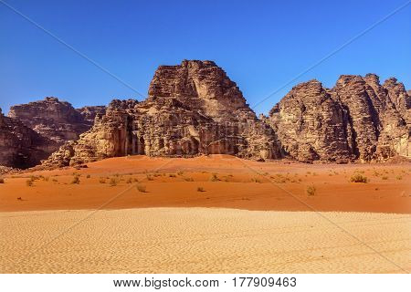 Orange Yellow Sand Rock Formation Wadi Rum Valley of the Moon Jordan. Inhabited by humans since prehistoric times place where TE Lawrence of Arabia in the early 1900s