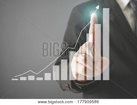 businessman pointing to trend line on graph