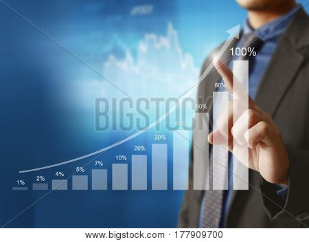 businessman pointing to increasing trend line on graph