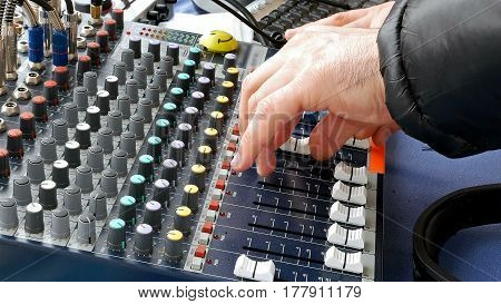 DJ hands play music on deck mixing console sound board