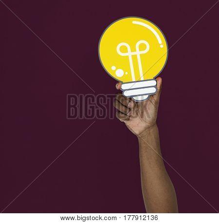 Human Hand Holding Lightbulb Idea