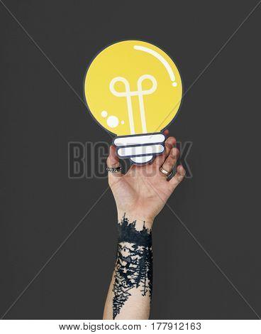 Human Hand Holding Light Bulb