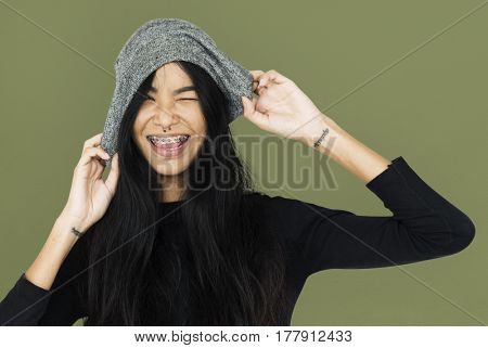 Young woman casual with tattoo holding beanie