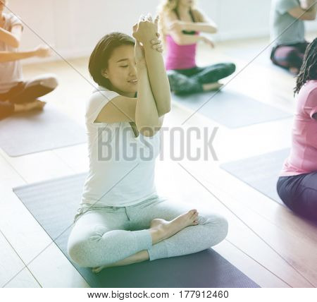 People are learning and sitting on mats
