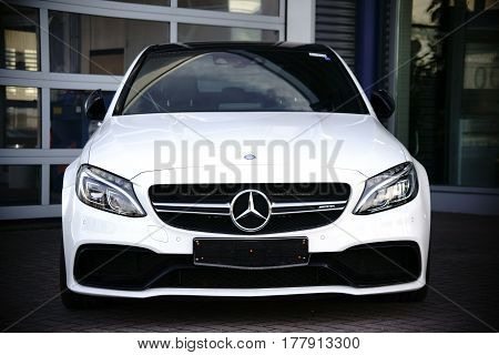 MAINZ, GERMANY - MARCH 10: The front view of a white brandnew V8 Mercedes AMG Biturbo on March 10 2017 in Mainz.