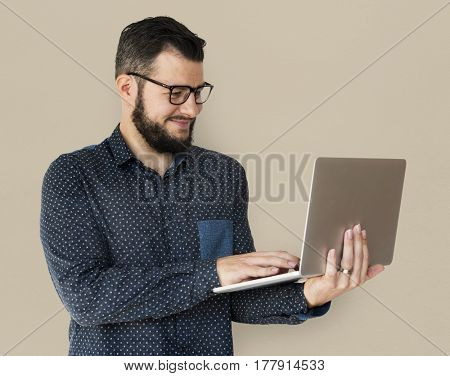 Man standing and holding laptop posing for shotoshoot