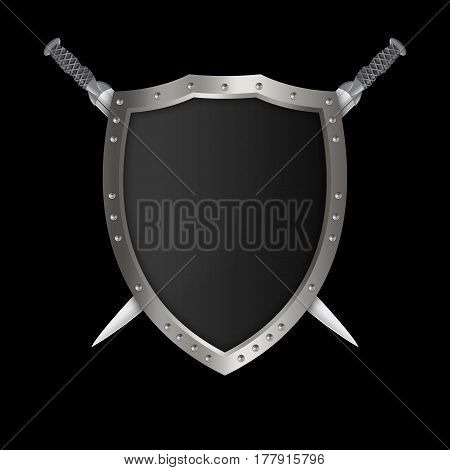 Medieval silver shield with riveted border and two swords on black background.